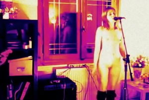 Nude damsel singing